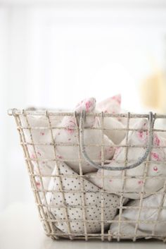 Cute French baby room idea: wire baskets as storage bins!