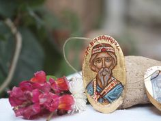 """The """"Grand Prince of Kiev, St Vladimir granson of Saint Olga handpainted in a mini wooden ornament that comes with a simple thread for hanging, The type of icons that I' really enjoy to paint - . My purpose is to make light and small original artifacts that could escort, assist and inspire their owner whenever he/she goes.The miniatures are painted with egg tempera in small gessoed wooden panels with size:"""