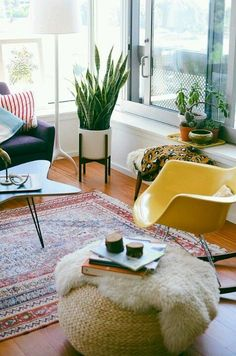 Decorating With Indoor Plants... personally, i love the living room furniture, too!