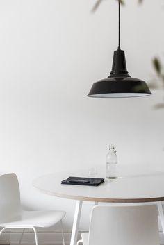 minimal white dining room wiht a vintage black industrial lamp and an olive tree Fantastic Frank Monochrome Interior, Scandinavian Interior, Workspace Inspiration, Interior Inspiration, Small Studio Apartments, Suspension Metal, Dining Room Lighting, Task Lighting, Lighting Ideas