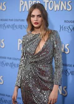Cara Delevingne looking the dreeeeeeam in a silver Saint Laurent dress with slashed neckline, at the Paper Towns premiere