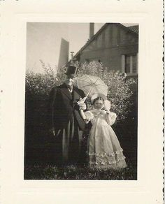 1900s /1920s French black and white  men and little girl costumes photography. via Etsy.