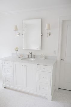 Simply White OC-117 by Benjamin Moore. White paint color by Benjamin Moore Simply White OC-117. Wall and cabinet paint color is…