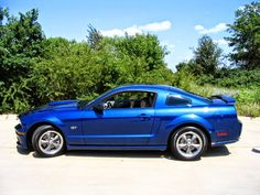My Kid in a 2006 Vista Blue Ford Mustang GT