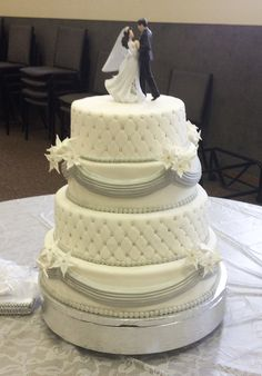 White and Sliver Wedding Cake! Red velvet, white chocolate cream cheese filling and Italian buttercream!