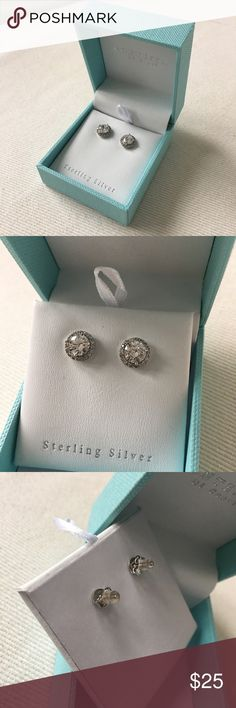 Contessa Di Capri CZ Sterling Silver Halo Earrings Gently worn condition. Has been cleaned. Comes with original box. CZ and crystal spinal stones. Sterling Silver post. 1cm total diameter. 🐾 Pet-friendly, smoke-free home. 🚫 No trades. No holds. 📦 Fast shipping! 🙋🏻 Considering all reasonable offers! Contessa Di Capri Jewelry Earrings