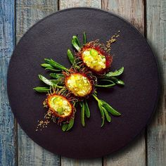 Stuffed rambutan with corn, cotija and Serrano #spicepopup . What's your favorite tropical fruit to use in savory dishes?