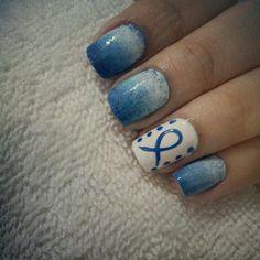 Cancer awareness nail art blue ribbon
