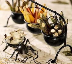 Cauldron Condiment Set #potterybarn - could be super cute, or just the idea of using cauldrons somehow for decor