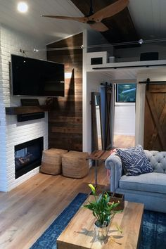 Living room with fireplace and coffee table in the Hawaii House by Tiny Heirloom.