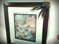 "Picture frame was ""misfigured.""  Hotglued feathers that coordinated with the picture and it looks great!  Feathers were purchased at a craft store."