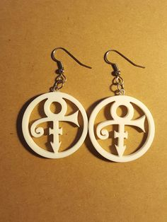 "Prince Symbol Upcycled corian earrings 1.25"" dia lightweight Prince Rogers Nelson Surgical Stainless wires These lightweight earrings are made from upcycled corian. When cabinet shops install counters"