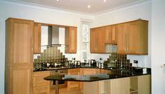 London N8 Solid Oak shaker kitchen with 30mm Black quartz worktops