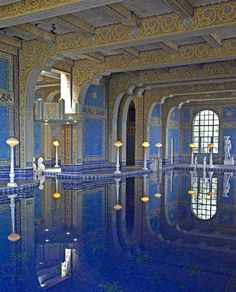 Its design based on Roman bath, this indoor swimming pool is decorated with statues of Roman gods, goddesses and heroes, and its tiles were inspired by patterns in the 5th Century Mausoleum of Galla Placidia in Ravenna, Italy. The entire room, from the bottom of the pool to the ceiling is decorated in one-inch square, glass mosaic tiles in cobalt blue and real gold.