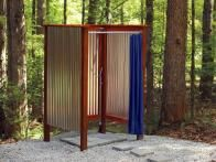 Learn how to build a simple, relatively inexpensive wooden outdoor shower for your backyard or garden with step-by-step instructions from HGTV Gardens.