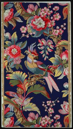Sidewall wallcovering with a large parrot and smaller bird on flowering branches. The seeming, not actual, ground is dark blue. Printed in 17 colours on a neutral ground, block-printed on paper. Made by Zuber et Cie. France, 1905-13