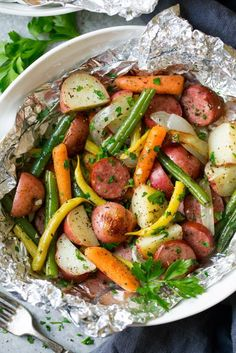 Easy Garlic Herb Sausage and Veggie Foil Packs Cooking Classy, Foil Packs with Sausage, Corn, Zucchini and Potatoes Recipe SimplyRecipes. Sausage Recipes, Cooking Recipes, Healthy Recipes, Cooking Foil, Cooking Eggs, Party Desserts, Foil Pack Dinners, Turkey Sausage, Smoked Turkey