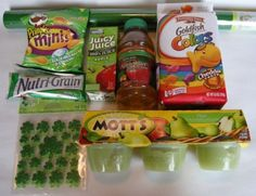 green applesauce  Apple juice with green label on bottle (I'm gonna dye this, too!)  Apple juice box in green packaging  Small bag sour cream and onion chips  Apple Nutri-grain bar  Rainbow Goldfish  Clear green Easter basket wrap (this is a must if you can find it!)  Clear green party treat bags   Pick out the green M's and make cookies   Clover stickers
