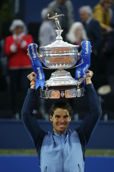 Rafael Nadal dethroned two-time defending champion Kei Nishikori on Sunday at the Barcelona Open BancSabadell to clinch his ninth title with a 6-4, 7-5 victory in two hours and four minutes.  In notching his 49th clay-court crown, the top-seeded Spaniard drew level with Guillermo Vilas atop the Open Era list. Nadal added a ninth trophy to his stunning haul in Barcelona. Vamos Rafa ! Objectif Roland Garros !  Photos: AFP; AP; Getty Images; EFE; Mundo Deportivo, Toni Albir
