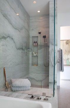 sea pearl quartzite for the shower walls. Pale greens and white with a darker lineal vein.