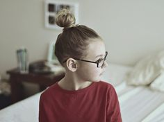 top knot and specs on kid