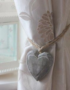 Curtain Tie backs! Put the wooden hearts to use.