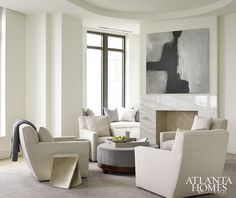 Interior designer Robert Brown set the living room's relaxing tone by painting walls and ceiling in Benjamin Moore's soothing White Dove.