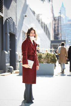Maria Dueñas Jacobs in a crimson robe coat. #refinery29 http://www.refinery29.com/2015/02/82279/new-york-fashion-week-2015-street-style-pictures#slide-94
