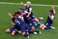 US wnt celebrating Carli Lloyd's first goal in their 2-1 Olympic gold medal win vs. Japan