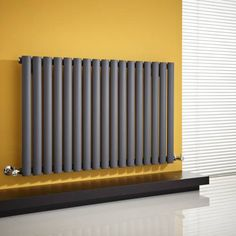 Milano Aruba - Anthracite Horizontal Designer Radiator x - Grey Anthracite Horizontal Designer Radiator in mustard yellow hallway Solid Brick, Brick And Wood, Wooden Flooring, Concrete Floors, Yellow Hallway, Horizontal Designer Radiators, Panel Radiators, Double Vitrage, Support Mural