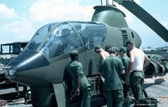 – Working on an Cobra, AHC. Photo by Brent Gourley. Note, one of two side rocket pods is visible at far right. Vietnam History, Vietnam War, First Indochina War, Military Guns, Military Aircraft, Helicopter Plane, Us Navy Ships, Us Army, Fighter Jets