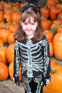 Cheap and easy skeleton costume! Get a black long sleeved shirt and long black pants from a thrift store and paint skeleton bones with glow in the dark paint. Fun and just a little spooky!