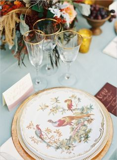 gold rimmed glasses and pheasant patterned plates #placesetting #weddingreception #weddingchicks http://www.weddingchicks.com/2014/02/14/hard-meets-soft-fall-wedding-inspiration/