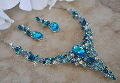 This beautiful necklace and earring set is made with sparkling clear and shades of blue crystals.