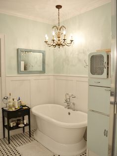 If we can't take down the tile on the walls in the bathroom, maybe we can cover it with board and batten or beadboard?