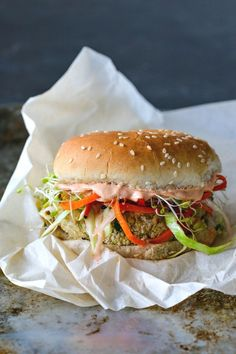 This White Bean Burger With Sesame Ginger Slaw + Gochujang Yogurt Spread is jam-packed with flavor and, best of all, doesn't fall apart when you eat it. Burger Recipes, Vegetarian Recipes, Healthy Recipes, Vegan Meals, Vegan Food, Vegetarian Burgers, Korean Recipes, Healthy Dishes, Savoury Dishes