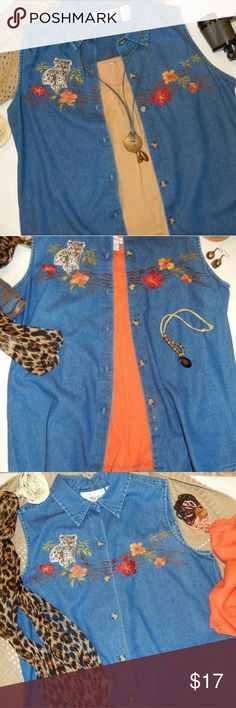"""Vintage Casey & Max Denim Blouse Size Medium This vintage sleeveless denim blouse has been lovingly stored in my home & is in excellent cond. The fabric is soft & not a heavy denim. Button front 100% cotton & embroidered with muted shades of orange, red & golden yellow flowers with brown stems, green leaves & a cheetah patch. Chest measures approx 21.5 from pit to pit & length approx 27"""" from center front shoulder seam. Casey & Max Tops Button Down Shirts"""