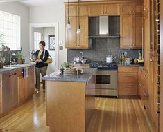 silver handles/knobs on wood cabinets to coordinate with stainless steel appliances