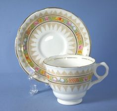 Vintage Cup and Saucer Set (Footed) in the Regency dinnerware pattern by Royal Stafford, Made in England. $25.99