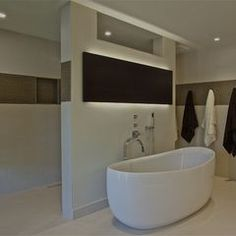 too modern, but LOVE shower behind wall no doors...maybe give up tub? modern bathroom by Anna Teeples Designs