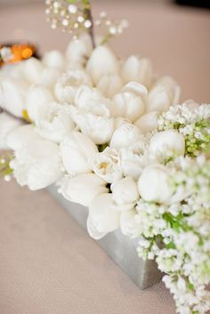A gorgeous spring centerpiece of white tulips. Photo Source: Snippet and Ink