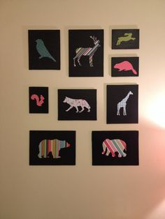 DIY nursery art. I painted some flat canvas panels with black acrylic paint and glued on different animals cut out of scrapbook paper.