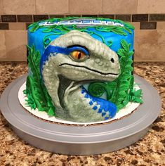 Cake I made featuring Blue the velociraptor from the Jurassic World movies!! Blue Birthday Cakes, Birthday Party At Park, Dinosaur Birthday Cakes, 7th Birthday Party Ideas, 10th Birthday, Dinosaur Party, Jurassic World Cake, Jurassic Park Party, Jurassic World Dinosaurs