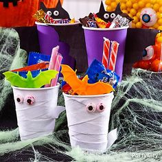 Your boo crew will go batty for these candy cup creatures! Get the cups, crepe paper, candy & favors from Party City! <3