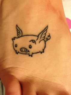 I got this tattoo in order to keep a piece of my childhood with me. I drew doodle because I always loved drawing as a child. I drew a flying pig because in third grade a teacher said I would make in this world when pigs flew. I later learned my problems in school were from a learning disabilities. Yet graduated at the 25% of my class with honors and scholarships. So in my mind pigs flew and I learned you can make anything of yourself! It's up to you and no one else!