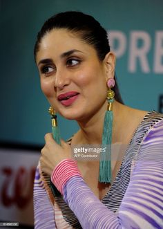 Indian Bollywood actress Kareena Kapoor Khan looks on during the launch of the book 'Pregnancy Notes before during & after' author by Rujuta Diwekar, in Mumbai on July / Get premium, high resolution news photos at Getty Images Indian Bollywood Actress, Beautiful Bollywood Actress, Most Beautiful Indian Actress, Bollywood Saree, Bollywood Actors, Bollywood Celebrities, Bollywood Fashion, Kareena Kapoor Photos, Kareena Kapoor Khan