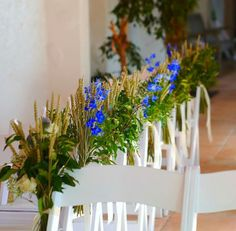Blue Delphinium and wheat pew ends by Austen Flowers