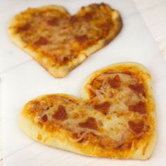 "Lately, we've struggled to get our two-year-old son to eat his dinner. He's at that super-fun toddler stage where he wants to eat the *exact* same thing every day. But when I made these Mini Heart Pizzas for dinner last week, he was really excited. He kept yelling, ""HEART!"" and pointing at his plate. If you're looking for an easy, fun was to incorporate Valentine's Day into dinner, these single-..."