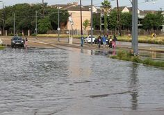 People and cars make their way through flood waters at the intersection on Fannin and Braeswood in the Medical Center on Tuesday, May 26, 2015 in Houston. Photo: Thomas B. Shea, For The Chronicle / © 2015 Thomas B. Shea