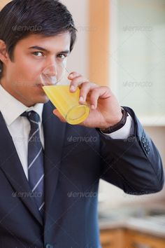 Buy Portrait of a businessman drinking orange juice by Wavebreakmedia on PhotoDune. Portrait of a businessman drinking orange juice in his kitchen Citrus Juicer, Orange Juice, Drinking, Author, Stock Photos, Portrait, Search, Beverage, Drink